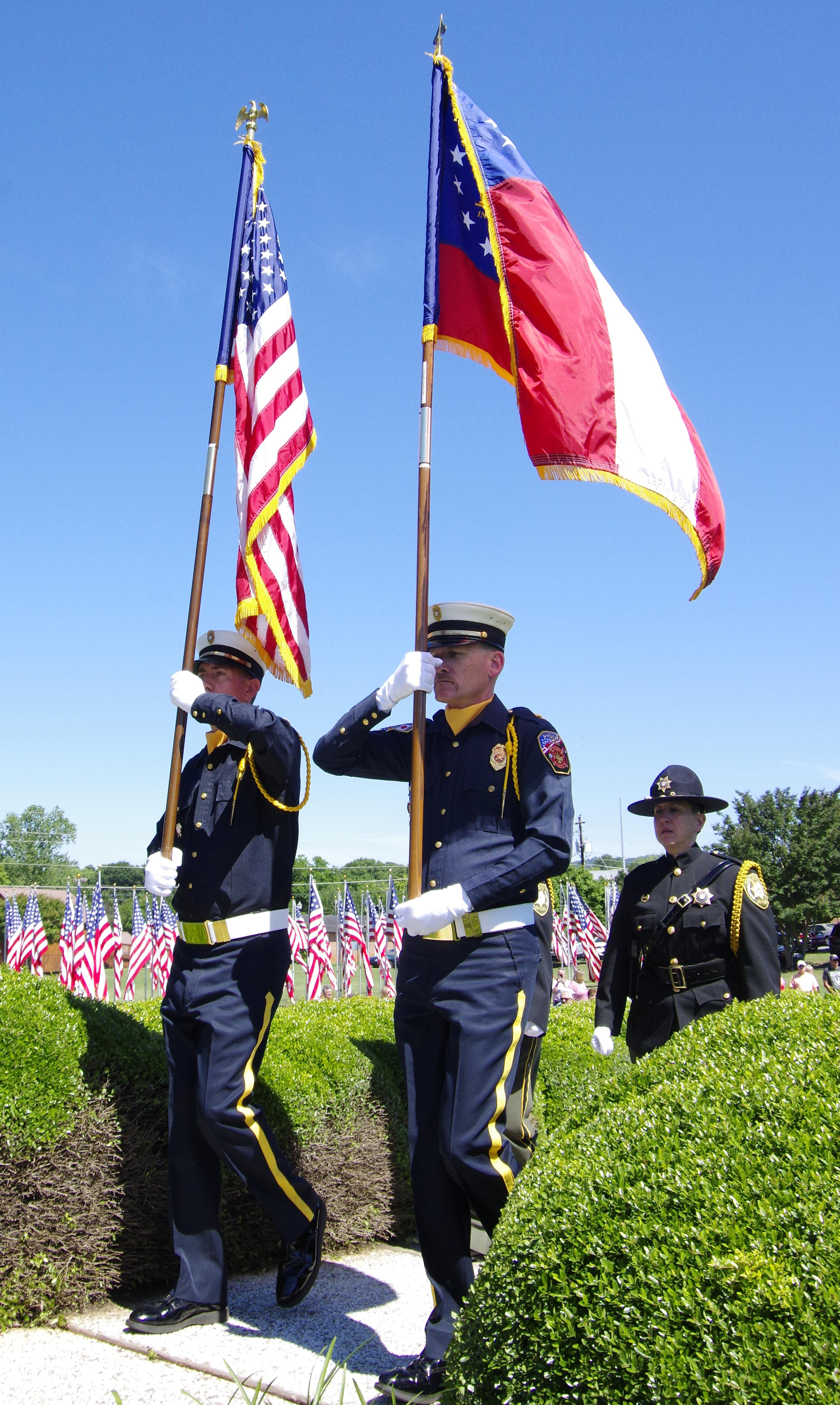The color guard presents the flags