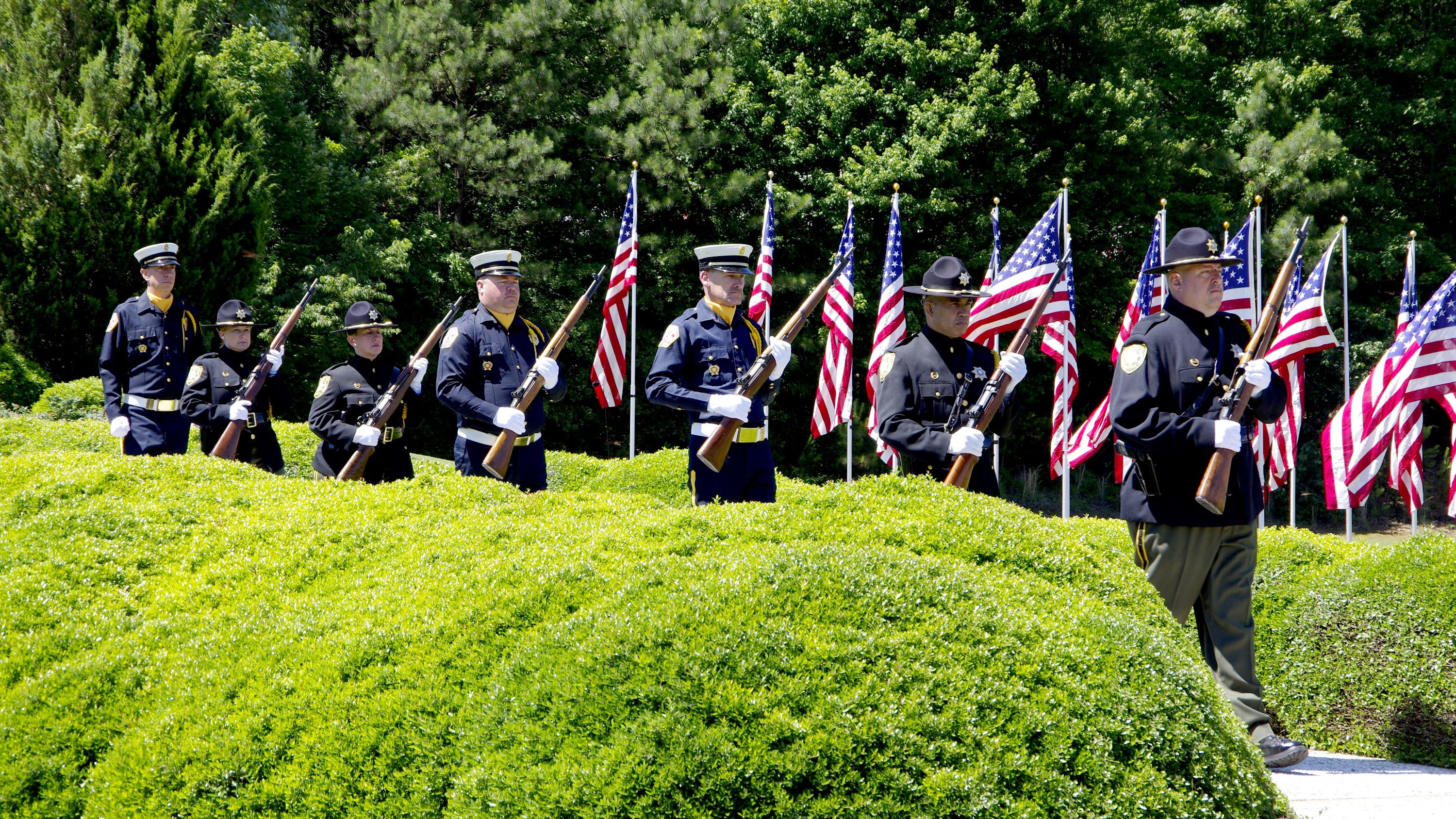 The honor guard rifle squad prepares for the salute