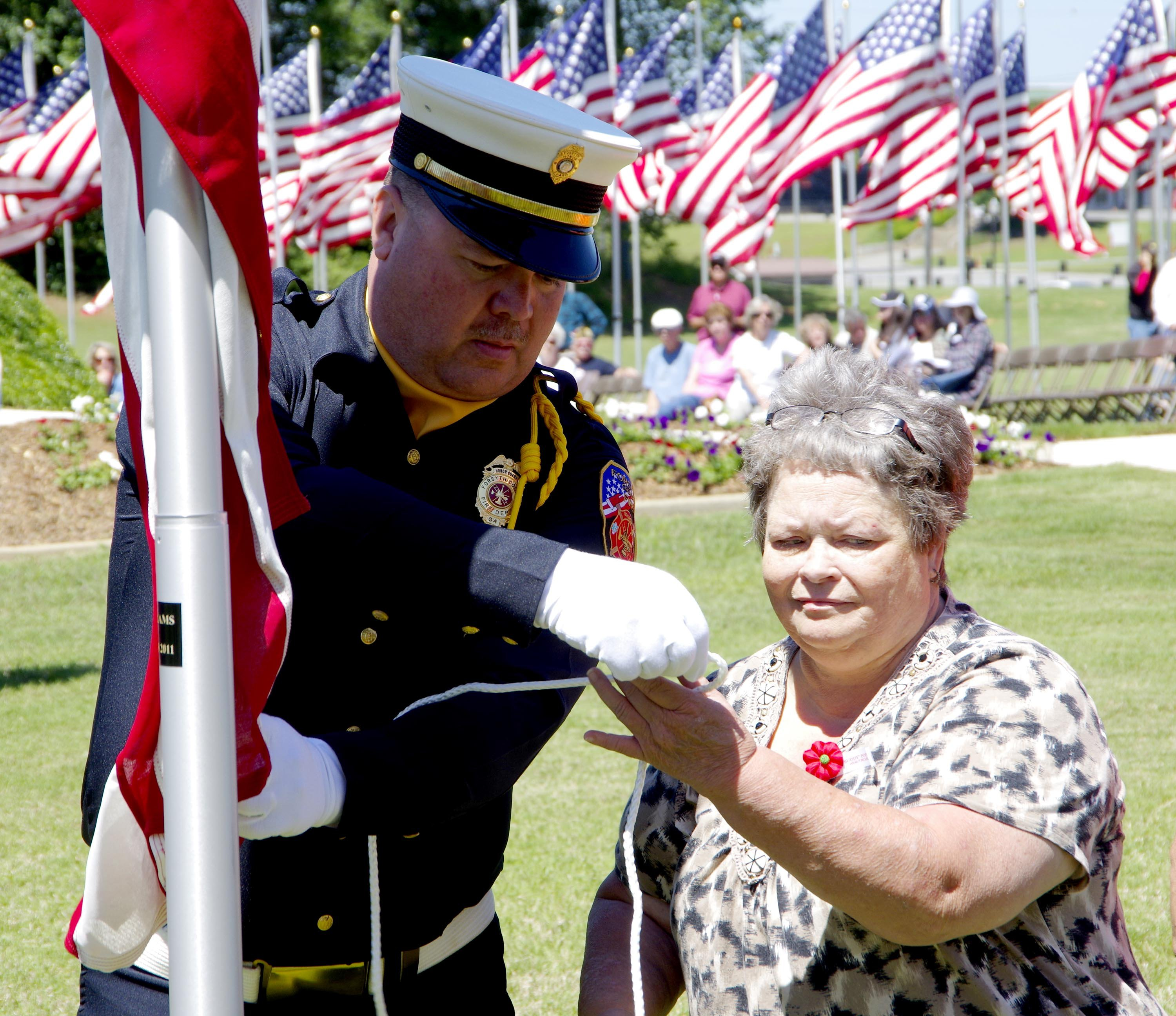 Family members participate in the flag dedication