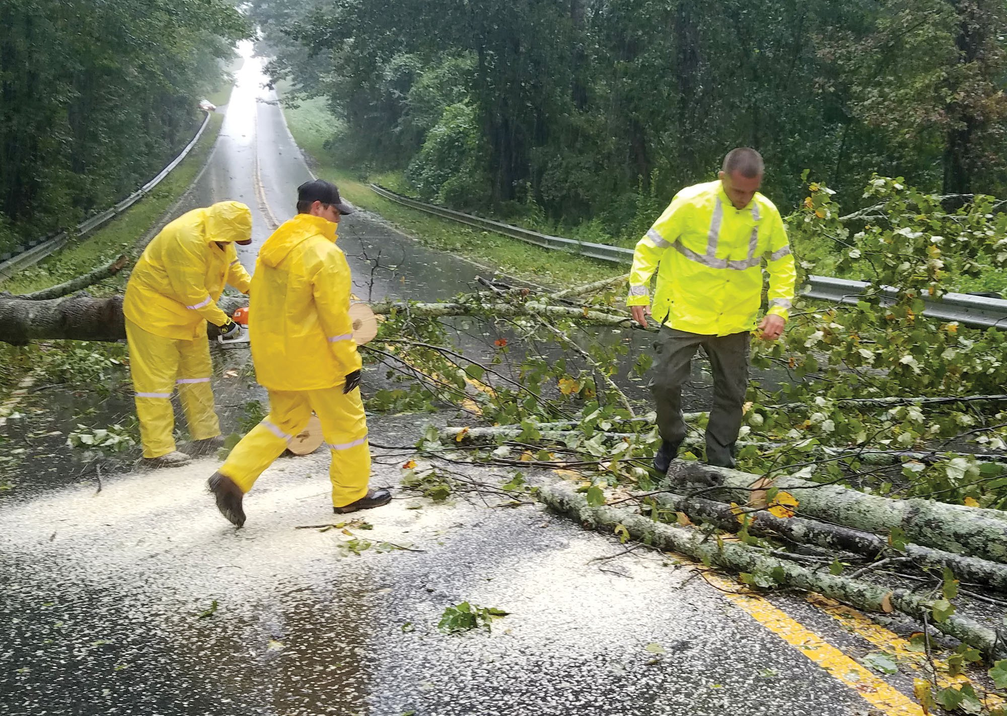 County employees worked together to clear the damage