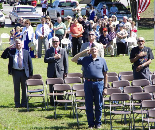 Veterans salute as the colors pass by