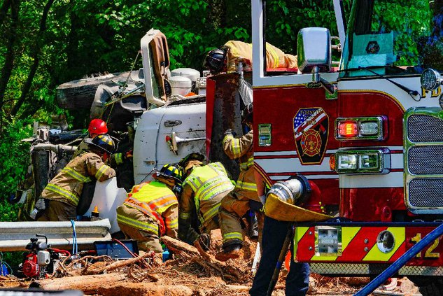 Overturned dump truck causing major delays on Ga  400